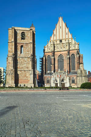 medieval campanile and facade of a Gothic church in the city of Nysa in Poland