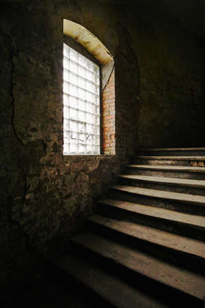 Wooden stairs of an old tenement house in Poznan Stock Photo