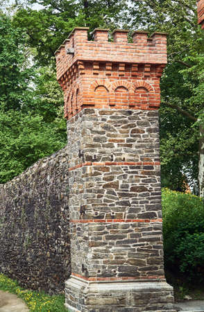 Medieval fortification with the city gate in Paczk