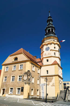 The town hall with clock tower and market in Otmuchow Stock Photo