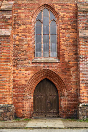 Portal and wooden doors of a medieval church in the city of Frankfurt (Oder)