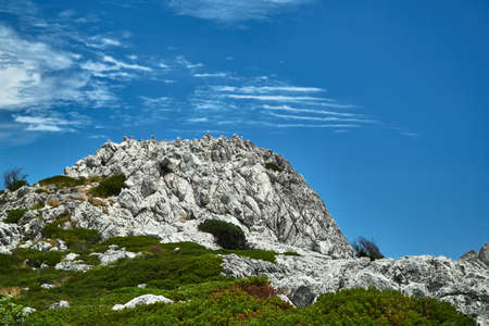 A white, volcanic rock against the sky on the island of Rhodes Stock Photo
