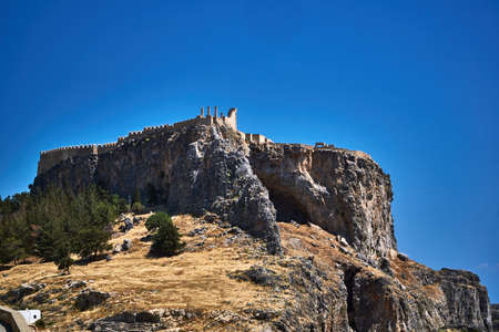 Ruins of the medieval Lindos castle at the top of the hill
