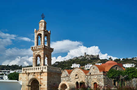 Bell Tower Orthodox Church and the ruins of Asklipio on the island of Rhodes Stock Photo