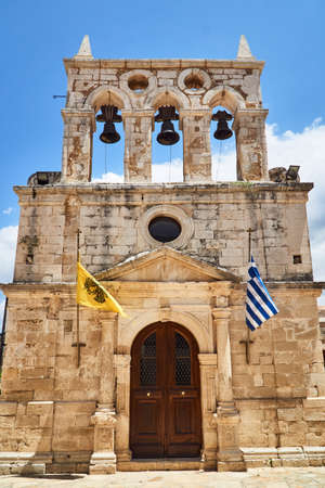 Facade and belfry of the historic church on the island of Crete