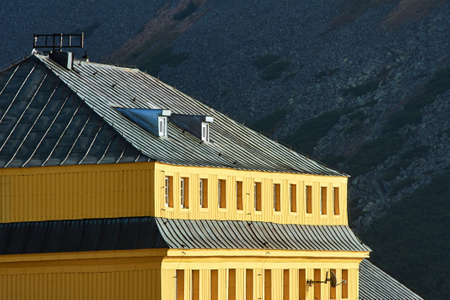 Yellow walls of a mountain hostel in the Giant Mountains in Poland