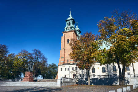 Statue and cathedral church in Gniezno, Poland Stock Photo
