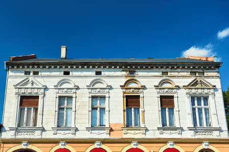 Facade of a historic tenement house in the city of Drezdenko in Poland