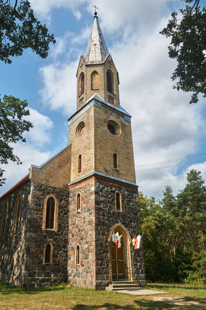 Neo-Gothic, historic parish church with a tower in Poland