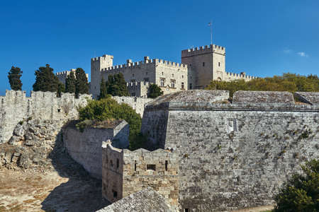 The moat and turrets of the medieval castle of the Joannite Order in the city of Rhodes Editorial