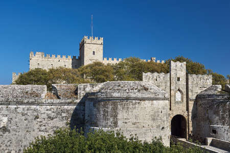 The gate of the medieval Castle of the Knights on the island of Rhodes