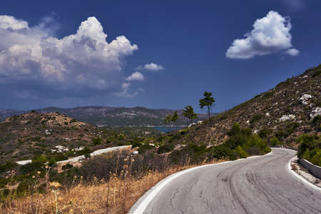 Asphalt road in the mountains on the island of Rhodes Stock Photo