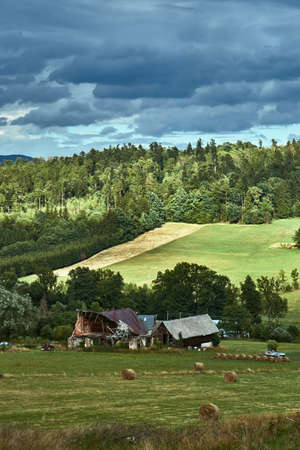 Rural landscape with a building in the mountains in Poland