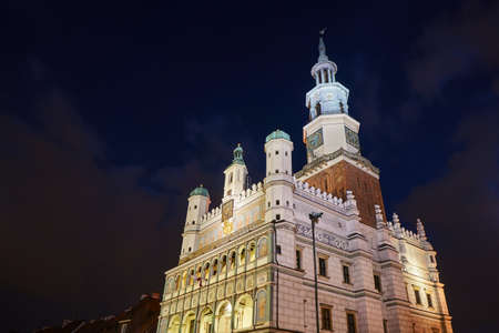 Facade of the Renaissance town hall at night in Poznan, Poland