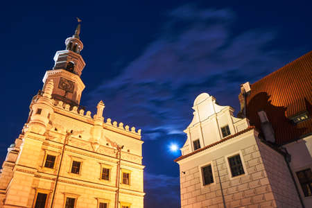 Clock tower of Renaissance town hall at night in Poznan, Poland