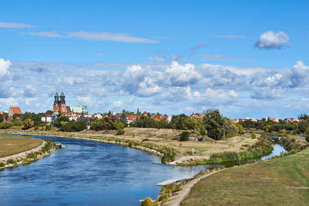 Urban landscape with river Warta and the cathedral towers in Poznan