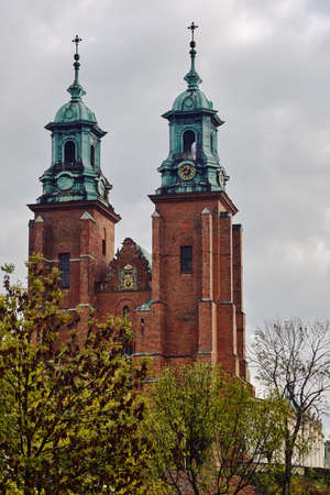 Towers of the gothic cathedral during autumn in Gniezno Stock Photo