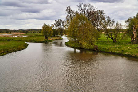 meadows and backwaters at the marsh at the mouth of the Warta River in Poland Stock Photo