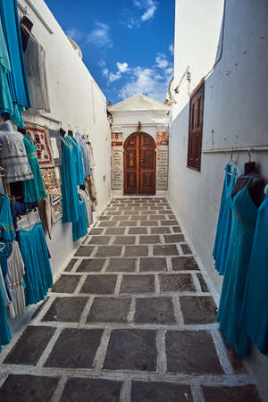 Narrow alley and the entrance to the city of Lindos on the island of Rhodes
