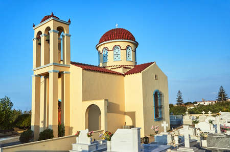 Orthodox cemetery and church with belfry on the island of Crete Stock Photo