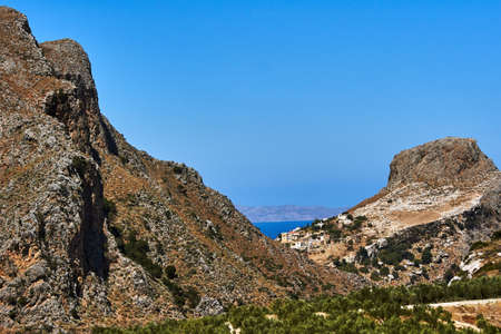 Rocky peak and olive trees on the island of Crete, Greece
