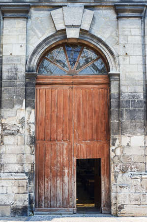 Portal and door of a historic church in the city of Troyes, France