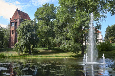Pond, fountain and medieval bastion of bricks in Szamotuly in Poland