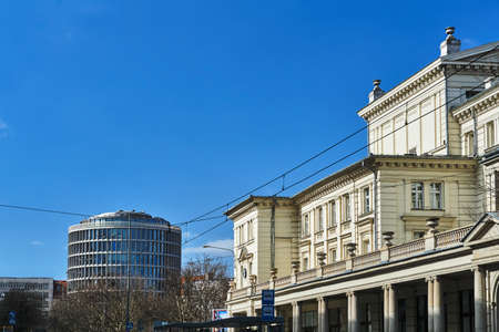 classicistic facade of a historic building and a modernist building in Poznan Stock Photo