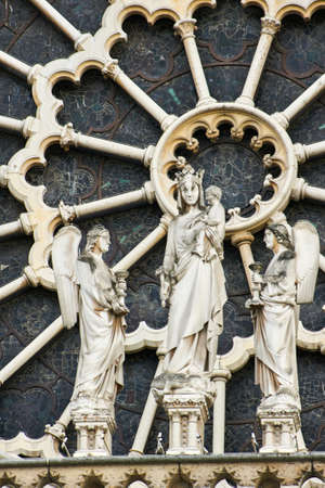 Stone statues on the facade of the cathedral of Notre-Dame in Paris, France