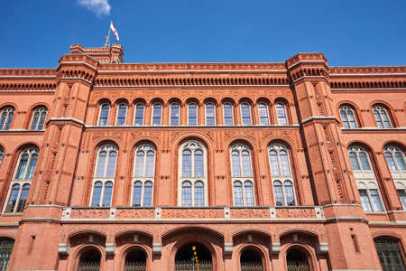 Neo-Renaissance Red Town Hall with the clock tower in the city of Berlin 写真素材