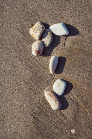 Pebbles on the beach on the Greek island of Corfu Imagens