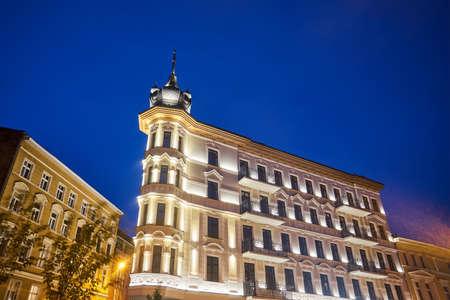 A rebuilt historic, Art Nouveau tenement house at night  in Poznan