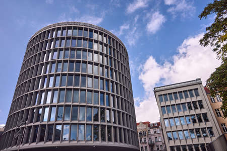 historic, modernist building in the shape of a cylinder in Poznan