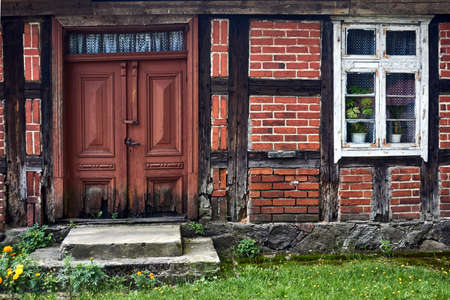 Wooden windows and doors of a historic country cottage in Poland