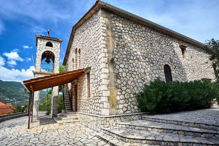 Belfry of the stone Orthodox church on the island of Lefkada in Greece