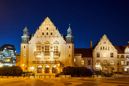 Neorenaissance facade of the building of the university auditorium at night in Poznan