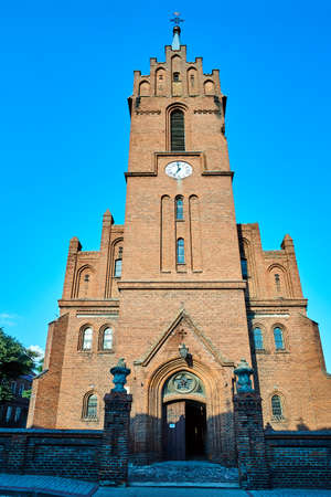 historic, Gothic red brick church with belfry in the city of Skwierzyna in Poland