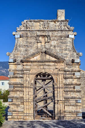 Gate and bell tower of the historic orthodox church of Evangelistria on the island of Kefalonia in Greece