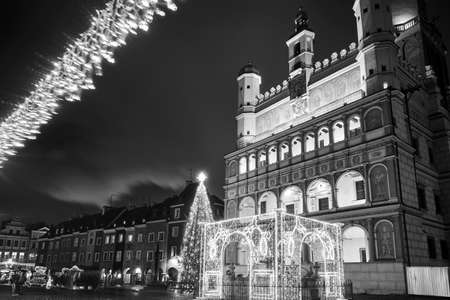 the facade of Renaissance town hall and christmas decorations in city of Poznan, monochrome
