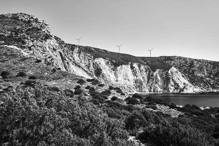 rocky coast and windmills on a hill on the island of Kefalonia in Greece, monochrome 版權商用圖片