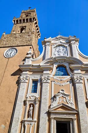 Belfry and baroque facade of an historic church in the town of Pitigliano, Italy