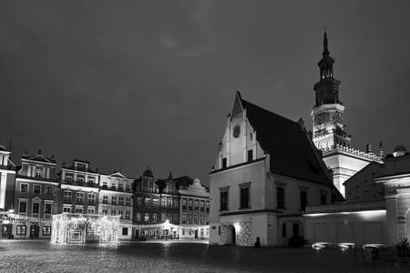 The Market Square with historic tenement houses and and christmas decorations in city of Poznan, monochrome