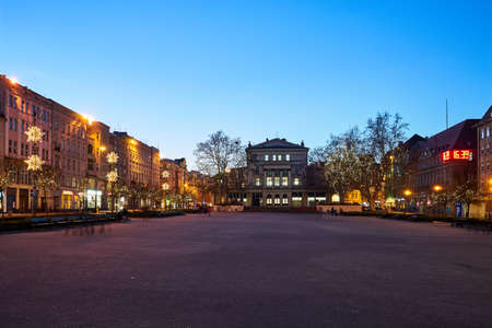 Vast square and buildings decorated for Christmas evening in Poznan Stock Photo