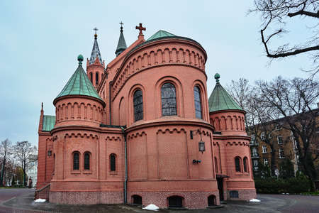 A historic, neo-Gothic Catholic church in the city of Poznan Stock Photo