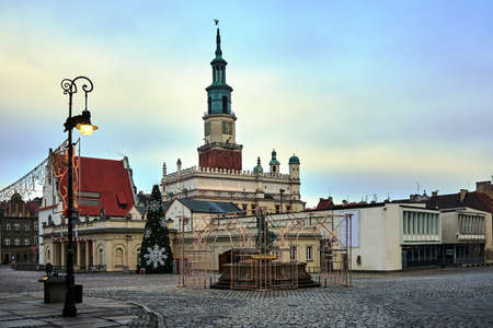 The historic buildings, tower town hall and Christmas tree in Poznan Stock Photo