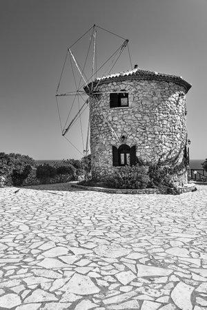 Traditional, historic, stone windmill on Zakynthos island in Greece, monochrome Stock Photo