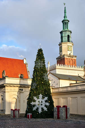 the christmas tree and tower of town hall in city of Poznan