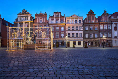 The Market Square with historic tenement houses and christmas decorations in city of Poznan