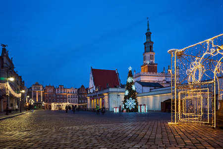 The Market Square with historic tenement houses, tower of town hall and christmas decorations in city of Poznan