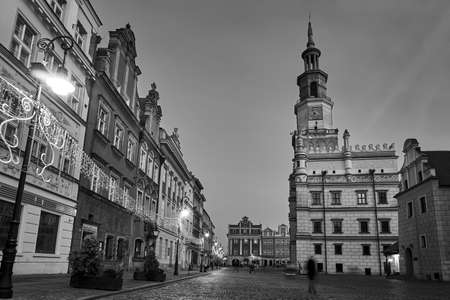 The Market Square with historic tenement houses, tower of town hall and christmas decorations in city of Poznan, monochrome